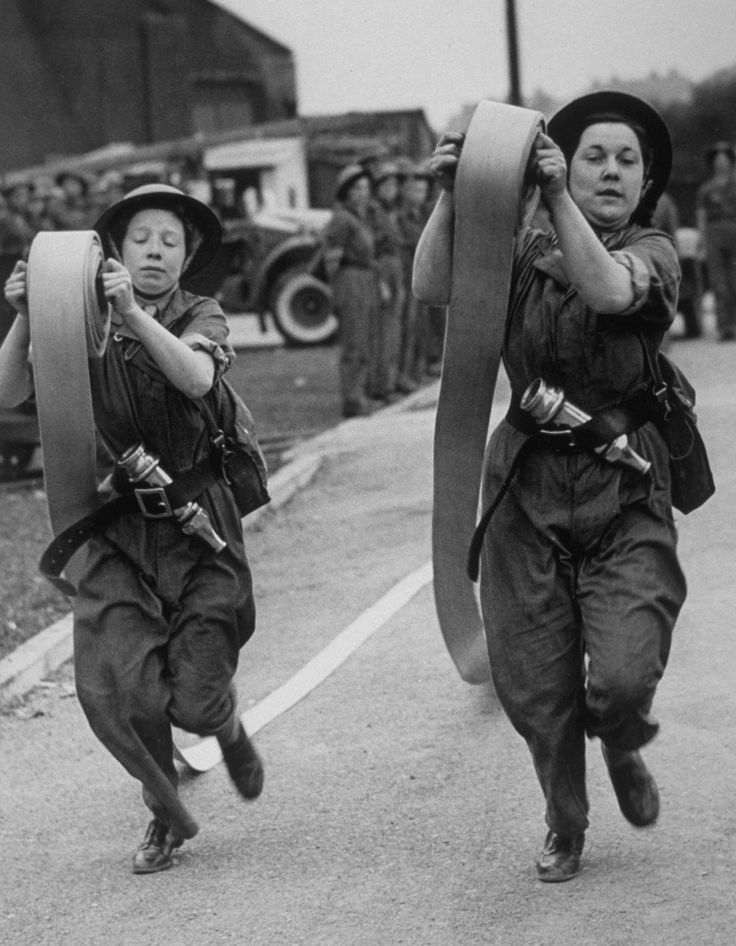 1942, Female firefighters during a skills demonstration. | 25 Stunning Vintage Photographs Of Female Firefighters