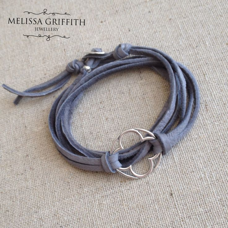 Clover Leather Wrap Bracelet (MGB96) $48.00 A heavy clover shaped centerpiece sets off this gray wrap bracelet. Butter-soft deer hide leather cord wraps around the wrist several times and secures with a sterling silver button clasp. The sterling silver clover accent measures 20mm. Fits a 6 to 6.5 inch wrist.