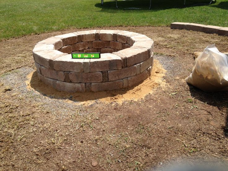 Finished fire pit rumble stone from home depot for Fire pit project