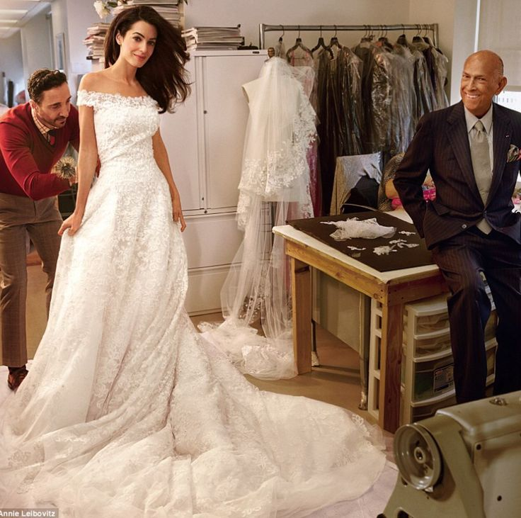 Amal Clooney in her wedding dress at a shop of De laa Renta's (worn at her wedding later)