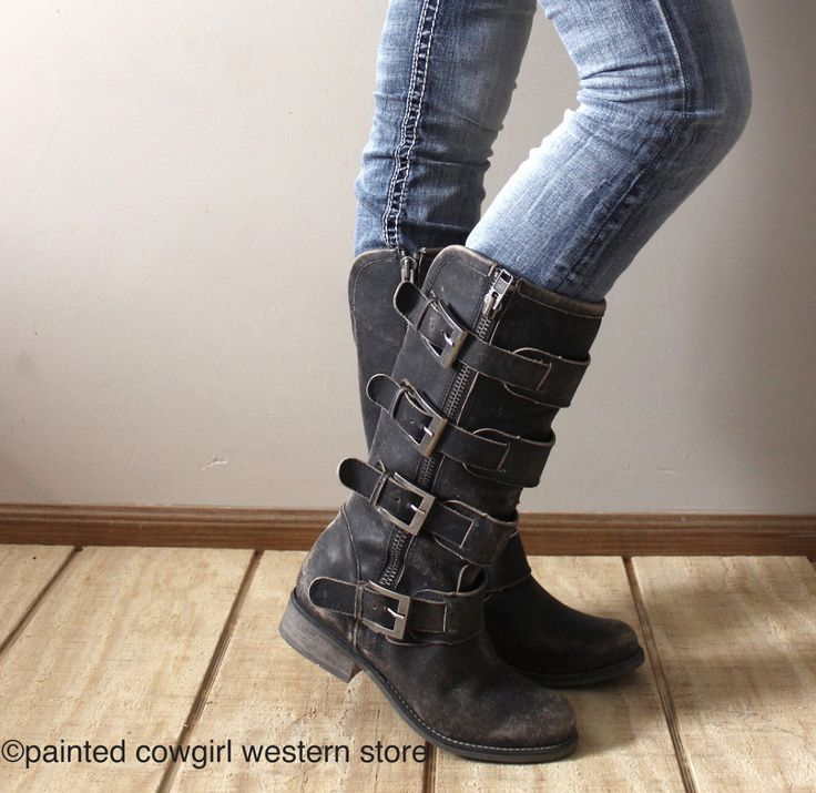 These uniquely designed women's boots are sure to turn heads. Handcrafted in distressed black leather, side zippers open up the boots for easier dressing and the four straps with buckles make for snug