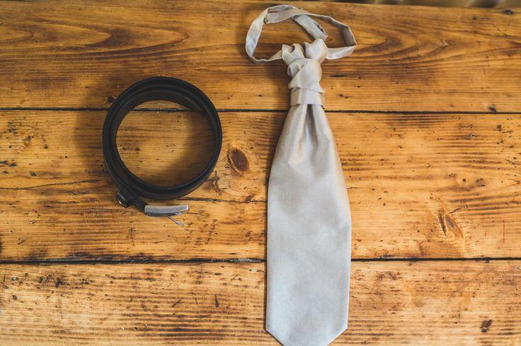 Grey tie, black leather belt