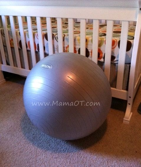 How to play with your baby on an exercise ball. Ideas for older babies and younger babies who are working on tummy time. from www.MamaOT.com