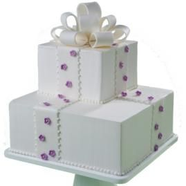 I like this. Replace the flowers with peace signes. keep the bow and make it cool colors. could be a 15th b'day cake???