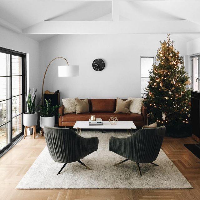 Cognac leather sofa and mid century furnishings.