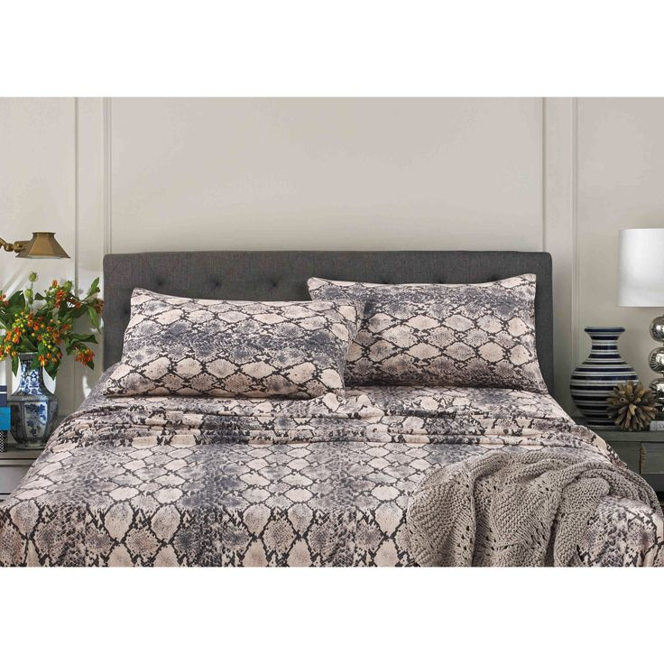 These luxurious snake print sheet set will bring a fashion forward, dynamic style to your bedroom in both soft neutral and bold hues. Woven of 300 thread count Egyptian cotton sateen, this sheet set includes oversized flat and deep pocket fitted sheet.