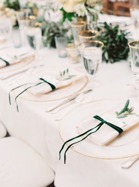 simple wedding place setting idea with blush table linens and emerald green velvet ribbons