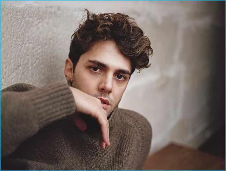 Xavier Dolan dons a brown fall sweater for his August Man Malaysia photo shoot.