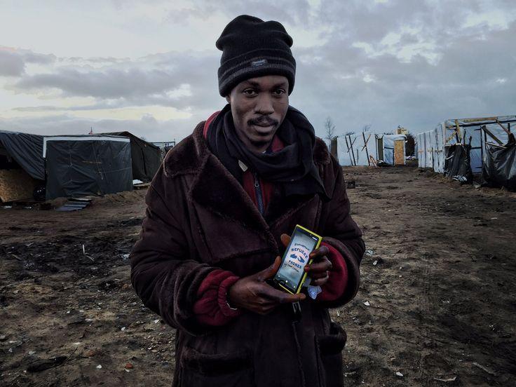 refugee phones migrant camp
