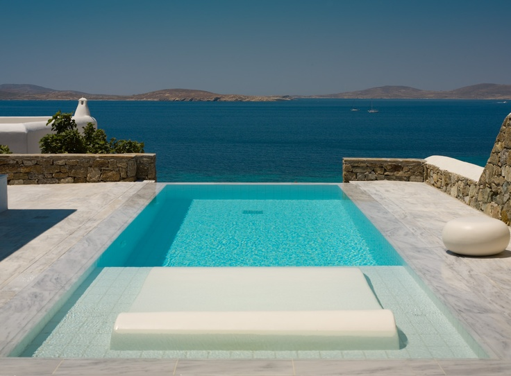 Grand Suite Infinity Private Pool with white marble around it, reflecting the blight sun rays, at Mykonos Grand Luxury Hotel
