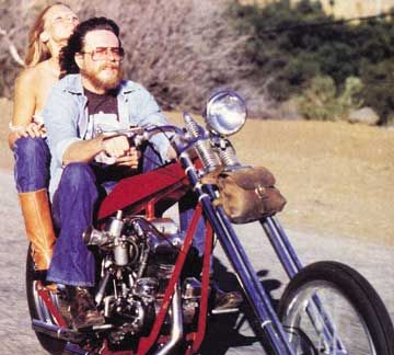 Jacquie and David Mann (artist - particularly know for his seminal graphic posters/paintings of biker lifestyle & choppers - as featured in 'Easyrider' magazine -Photo by Billy Tinney
