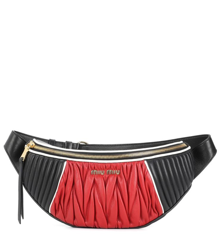 Miu Miu - Matelassé leather belt bag - The belt bag is the season's key accessory, and Miu Miu gives the trend its own signature spin with this quilted matelassé leather piece. In a bold red and black colourway, this design features an adjustable strap for a snug fit and glossy golden hardware. seen @ www.mytheresa.com