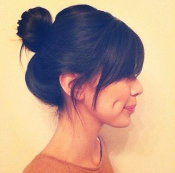 A cute and casual bun always looks great with sweeping bangs.