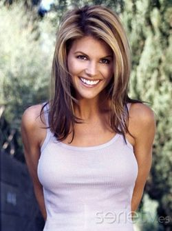 Lori Loughlin  - 2018 Dark brown hair & Bun hair style.