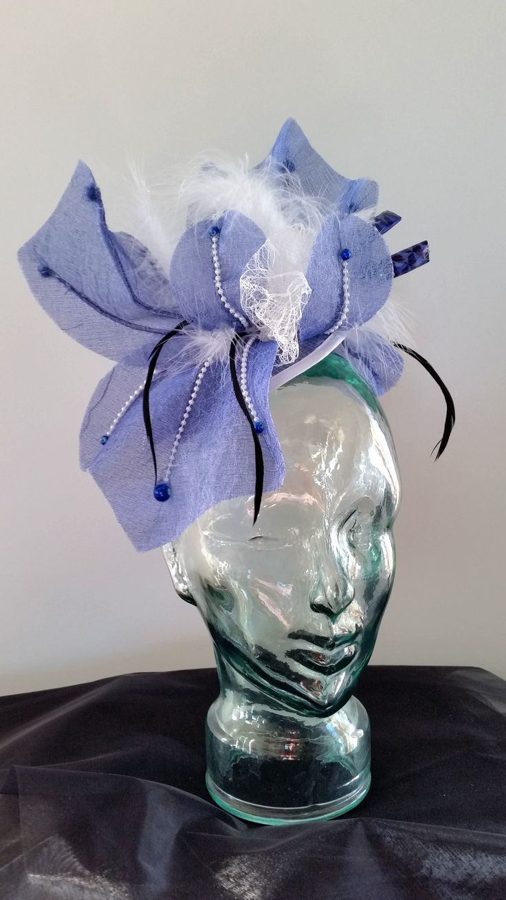 Blue organza and feather designed for the lady who not  fraid to make a statement
