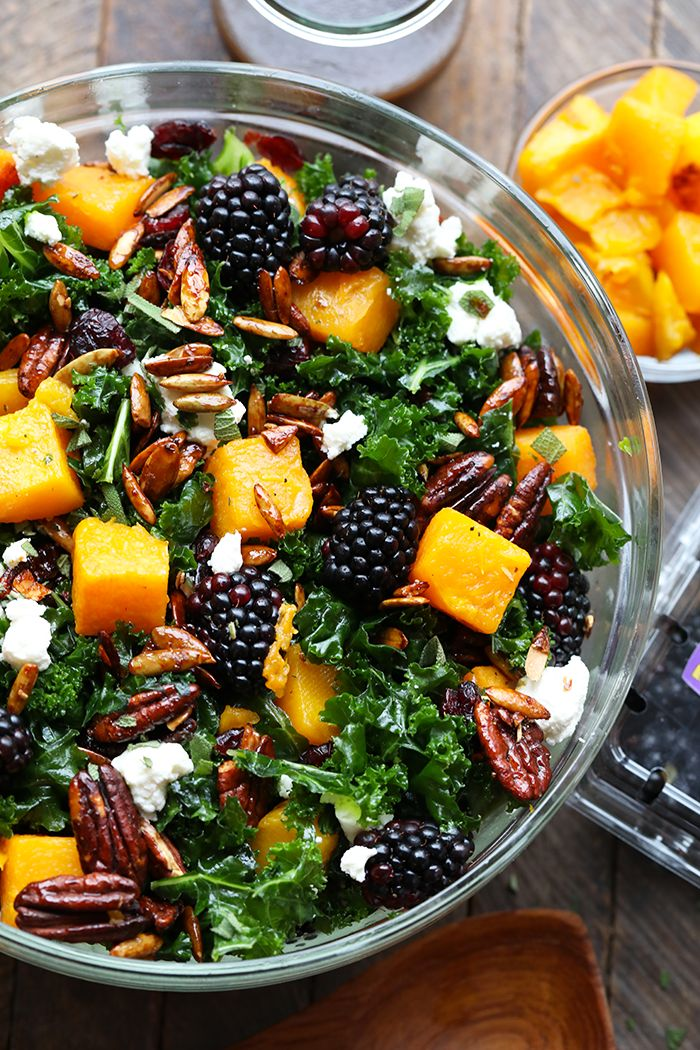 ThisHarvest Blackberry and Butternut Squash Massaged Kale Salad is an excellent healthy lunch or dinner and even doubles as a holiday salad to share. It's made with roasted butternut squash, candied nuts, Driscoll's blackberries, and massaged kale with a homemade dressing!