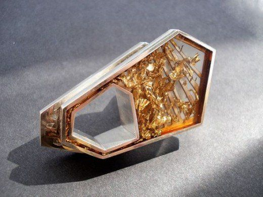 Ultra modern ring with a section of resin containing gold foil pieces.
