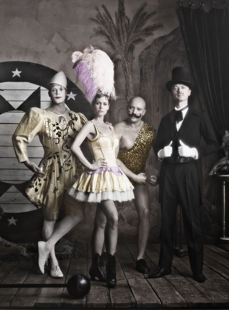 Circus represent.love the glitzy bling outfit of the strong man in this vintage photo of circus performers...he's really in touch with his feminine side