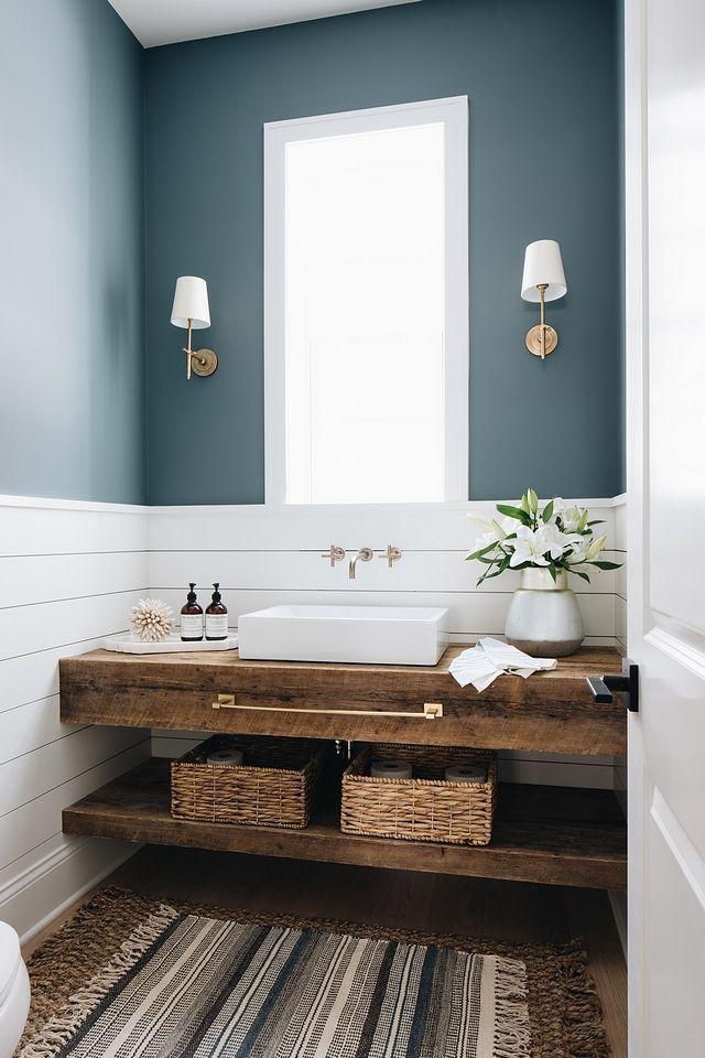 Farmhouse Bathroom features shiplap wainscoting an…