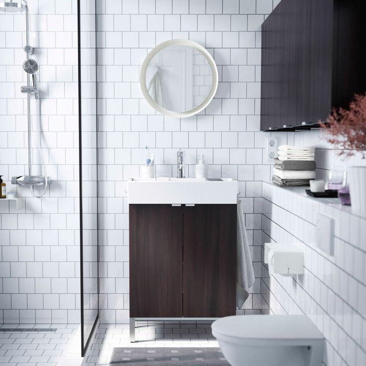 HALLWAY BATH: A small white bathroom with LILLÅNGEN washbasin and wall cabinets in black brown.