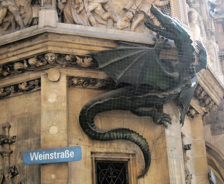 Awesome dragon climbing the wall of the city hall in Munic.