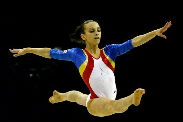 Ana Pogras Photos Photos - Ana Pogras of Romania competes in the floor exercise during the Apparatus Finals on the sixth day of the Artistic Gymnastics World Championships 2009 at the at O2 Arena on October 18, 2009 in London, England. - Artistic Gymnastics World Championships 2009 - Day Six
