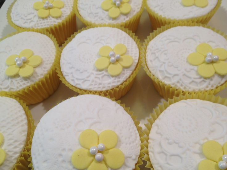 Lemon coconut cupcakes with imprinted fondant tops!