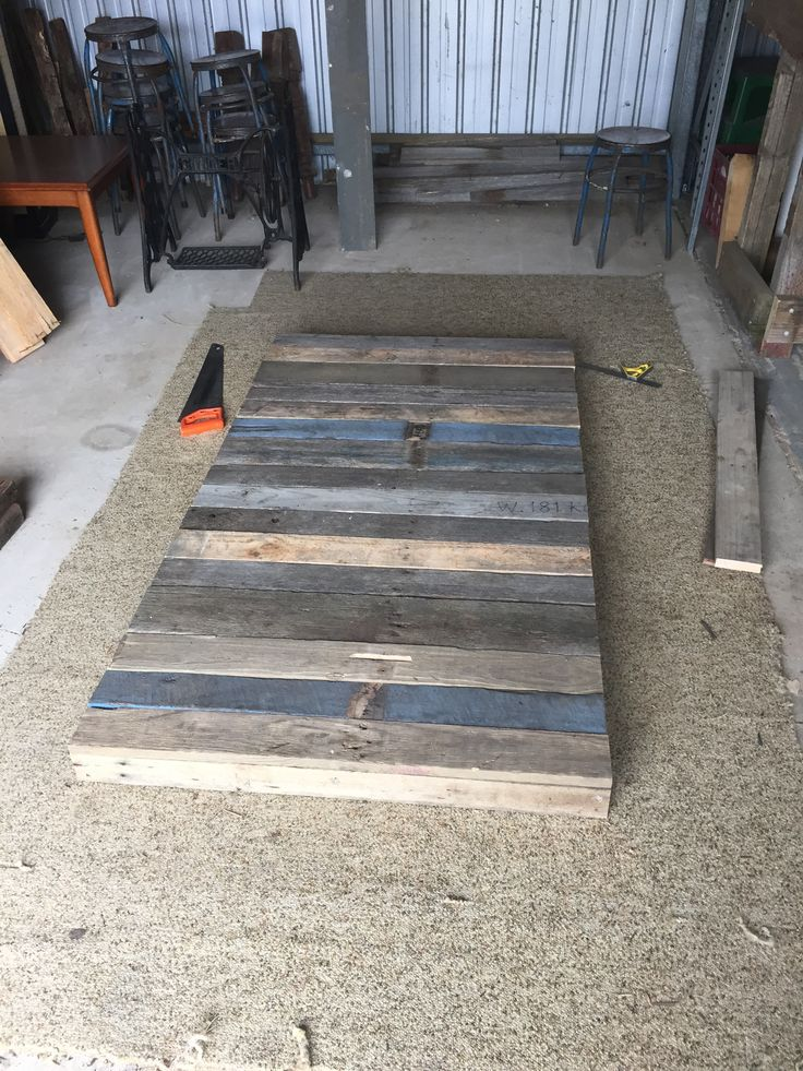 Measure and cut pallet boards to size and screw down.
