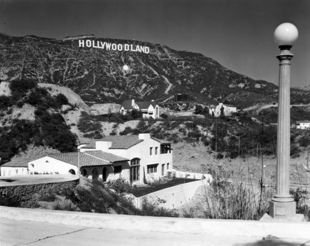The Hollywood sign was erected in 1923 to promote the 'Hollywoodland' real estate development. By the 1940s, it was in disrepair, and neighbors wanted it torn down. In 1949, the Hollywood Chamber of Commerce pushed to have the sign repaired and rebuilt, removing the 'land.'