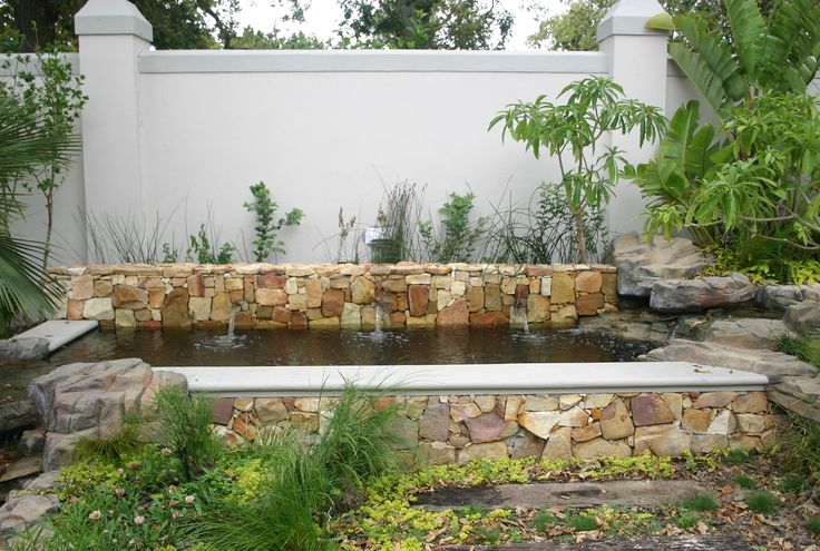 Stone Mason Water Feature On Rectangle Pond With Natural Wetland Filtration Water Features