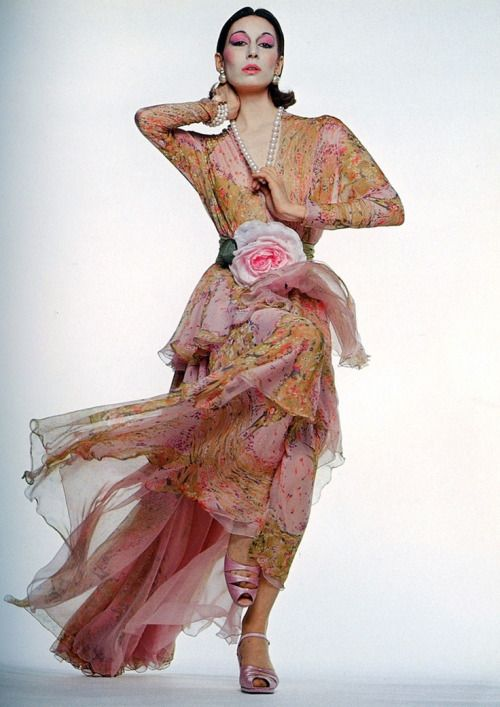 Anjelica Huston wearing a gown by Valentino, 1972. Photo by Gian Paolo Barbieri.