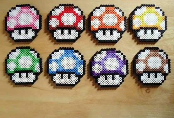Mario Mushroom Keychains made from perler beads with a metal chain and keyring attached.