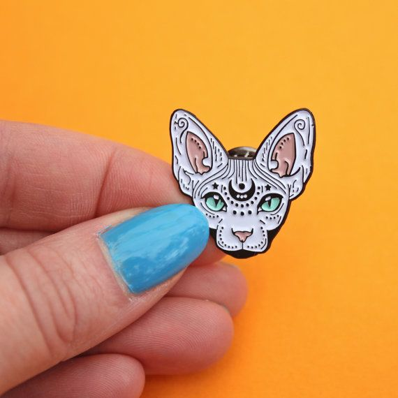 Mystical Sphynx Cat pin.  These little guys have been created from my original drawing & would make a fab gifts for cat lovers (or yourself!)  These pins feature coloured soft enamel & black plating. Each pin has a black metal clutch backing & is approx 32mm in size at longest point.  Your pin will be attached to a printed backing card, wrapped in a coloured paper giftbag, and be sent in a padded envelope to ensure it gets to you safely.  If you have any questions please feel free...