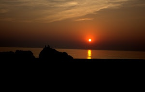 Sunset at a beach by Prasanna Bhat -  Click on the image to enlarge.