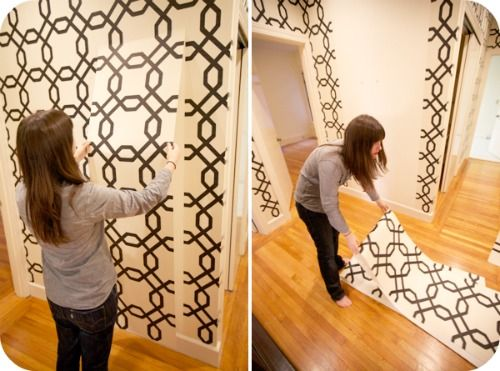YES! Using starched fabric for walls instead of wallpaper! Now I can decorate my walls in my no-paint-allowed apartment. I am thrilled to try this. Take THAT UMD!