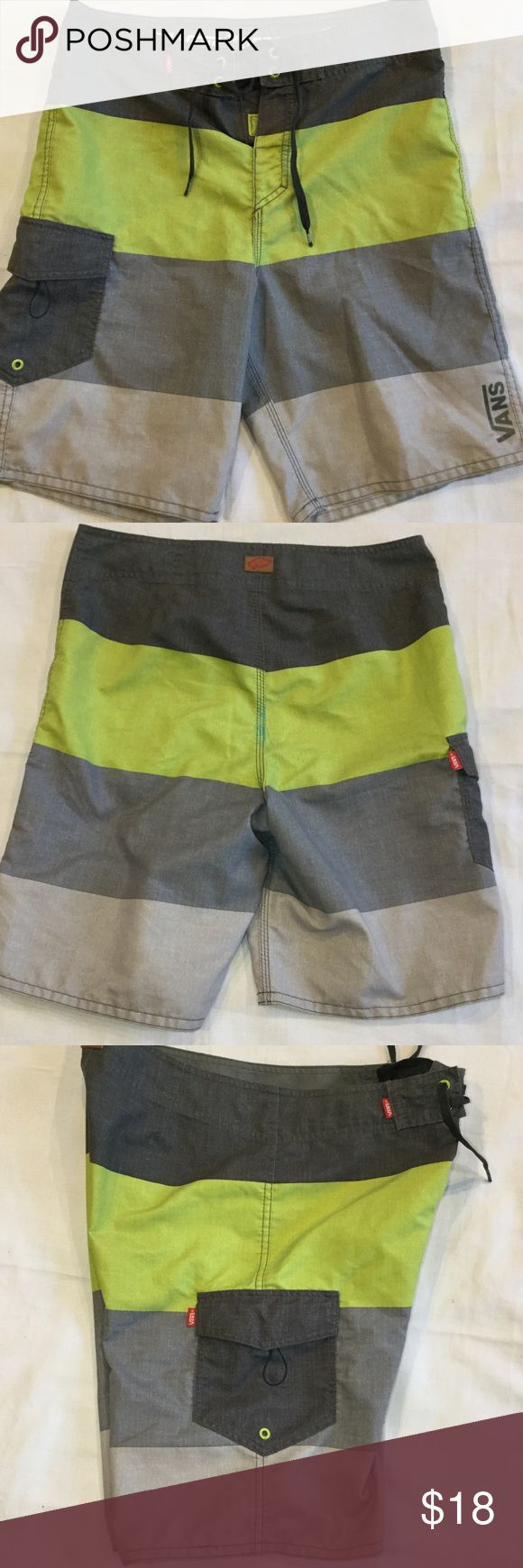 VANS Board Shorts Off The Wall Swim Trunks Mens Vans Board Shorts Off The Wall Swim Trunks Gray Neon Lime.Awesome pair of Men's board shorts by VANS! They are gray & neon lime striped. VANS label on the side and front bottom. Velcro & tie closure Side pocket with velcro This Item have been Worn but has no visible signs of wear in Excellent Condition. Vans Swim Board Shorts