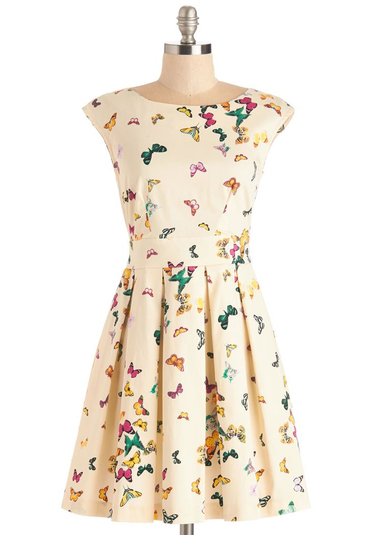 Fluttering Romance Dress in Colorful Butterflies. Ah, that familiar pitter-patter of the heart you feel after slipping into this ivory frock by Closet! #cream #modcloth