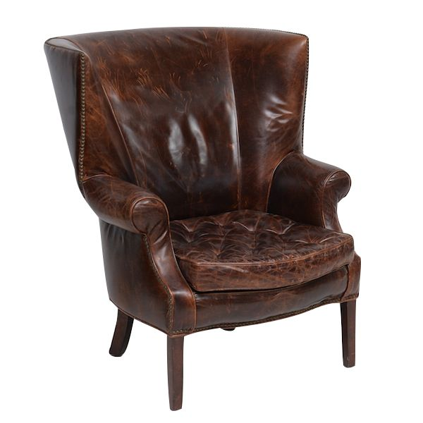 Bourbon Leather Armchair at Found Vintage Rentals. These rich dark brown leather armchairs are the epitome of masculine sophistication.