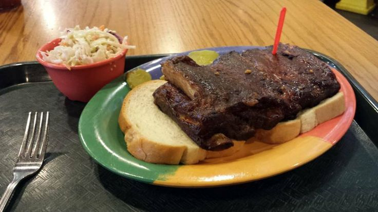 Arthur Bryant's - 1702 Village W Pkwy, Kansas City, KS | Long-side ribs with coleslaw at Arthur Bryant's in KC. |Arthur Bryant's legendary Kansas City BBQ started here and continues today!  This BBQ legend was founded in the early 1920's, by Charlie Bryant, Arthur's older brother. When Charlie died, Arthur took over and moved the BBQ restaurant to 18th and Brooklyn, just four blocks away from Municipal stadium, the home of the Kansas City Blues, followed by the Kansas City Athletics…