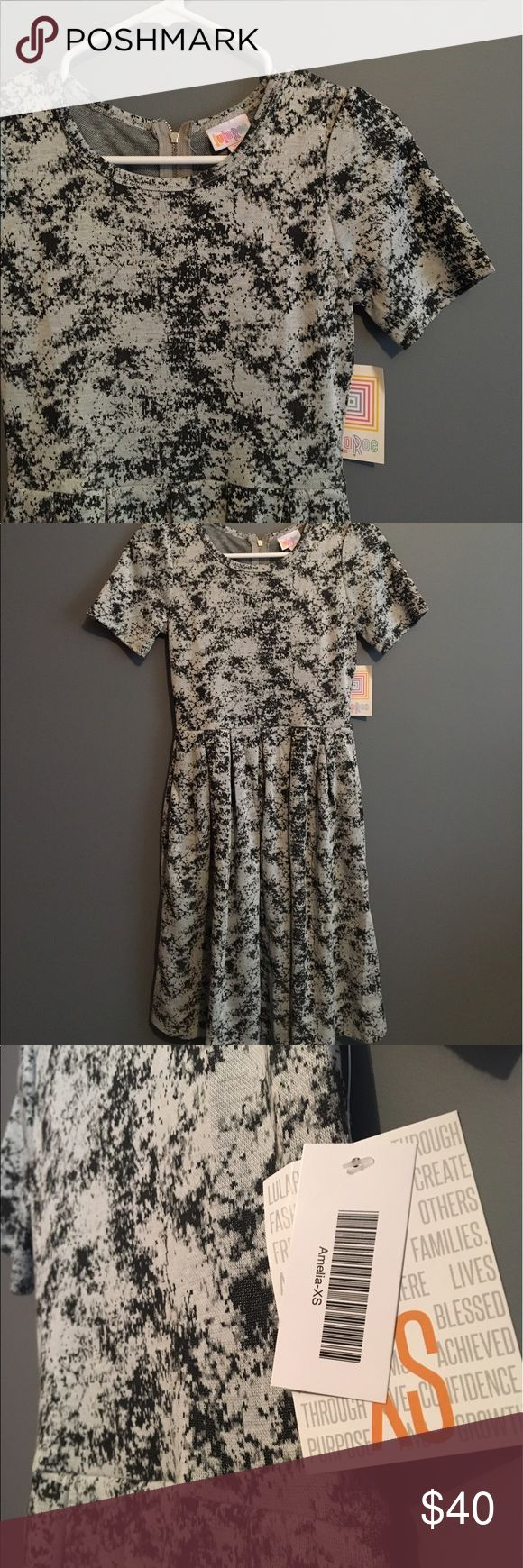 Lularoe Grey Amelia Perfect for a business casual event or just a night out with the girls! Always wear a size down in lularoe so if you typically wear a small or medium sized dress, you should fit in an XS! LuLaRoe Dresses Midi