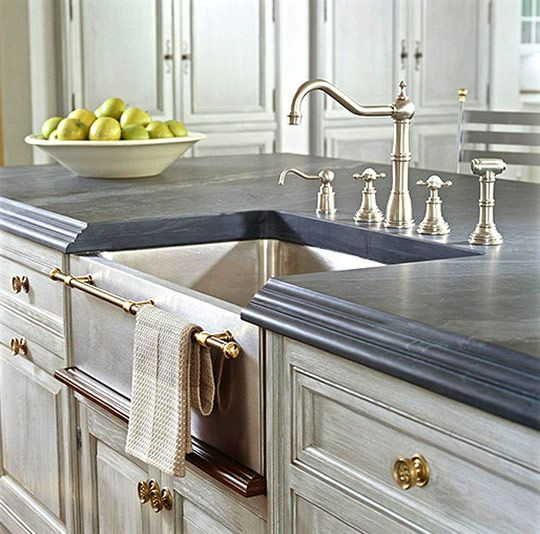 Elegant gray-blue #Cardosa #limestone resembles soapstone but is harder and more durable, says designer Christopher Peacock, who chose it for a Lake Forest, IL show house.