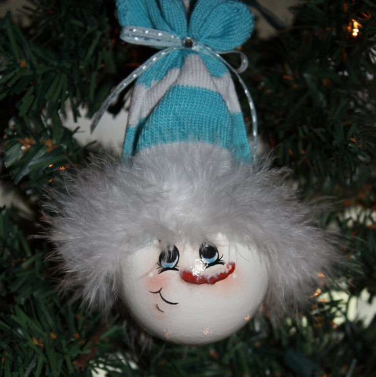 "Hand Painted ""Baby Blue"" Snowman Light Bulb Ornament. $11.00, via Etsy."