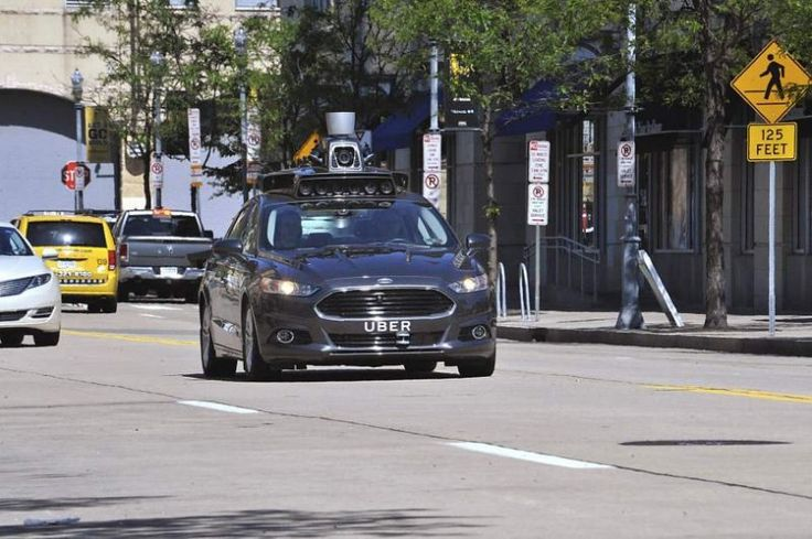 Uber's self-driving Ford Focus hybrids are cruising around the streets of Pittsburgh