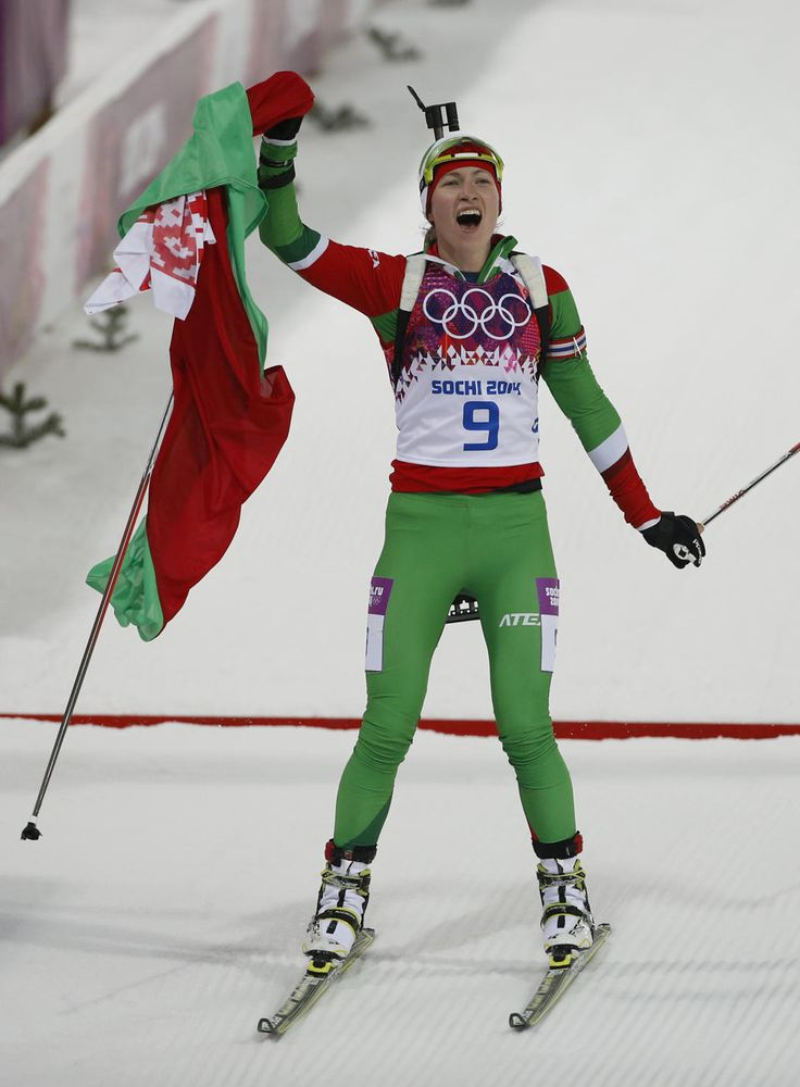Domracheva wins Olympic gold in 10K pursuit - Belarus' Darya Domracheva celebrates after winning the gold medal in the women's biathlon 10k pursuit, at the 2014 Winter Olympics, Tuesday, Feb. 11, 2014, in Krasnaya Polyana, Russia. (AP Photo/Felipe Dana)