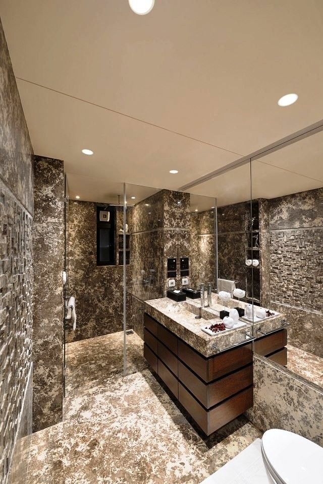 Conceptually Designed Bathroom View The Walls Treated With Italian Stone Work Having Grooves T Best Bathroom Designs Bathroom Design Luxury Bathroom Design