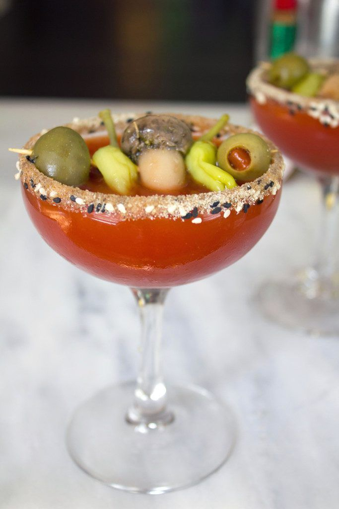 I combined my two favorite cocktail into one with this Manhattan Dirty Mary Martini -- The bloody mary and dirty martini unite! | wearenotmartha.com