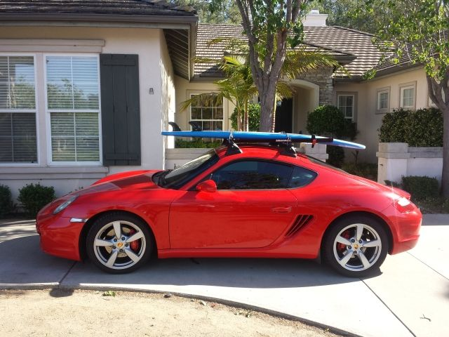 My Cayman with roof rack for bikes and surfboard