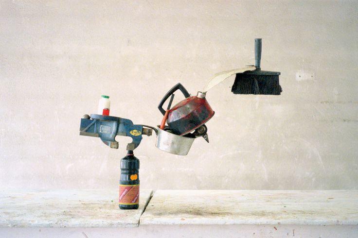 "a 1986 photograph called ""Der Blütenzweig"" (""The Blossoming Branch""), by Swiss artists Peter Fischli and David Weiss"
