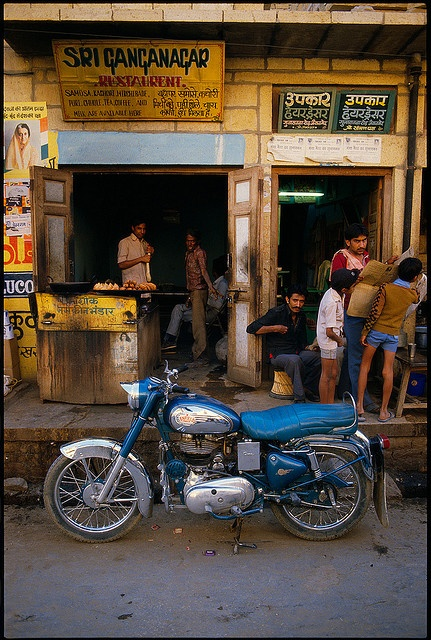 Motorcycle in front of restaurant. Rajasthan, India