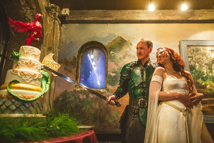 Of course you cut your dragon themed wedding cake with a seriously,massive sword!